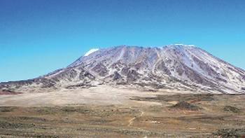 Mt Kilimanjaro rises above the flat African plains | Gesine Cheung